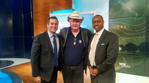Weather Geeks hosts Chris Warren (left) and Dr. Marshall Shepard (right) pose with the show's first guest, Dr. Charles Doswell (center) on the Weather Geeks set.