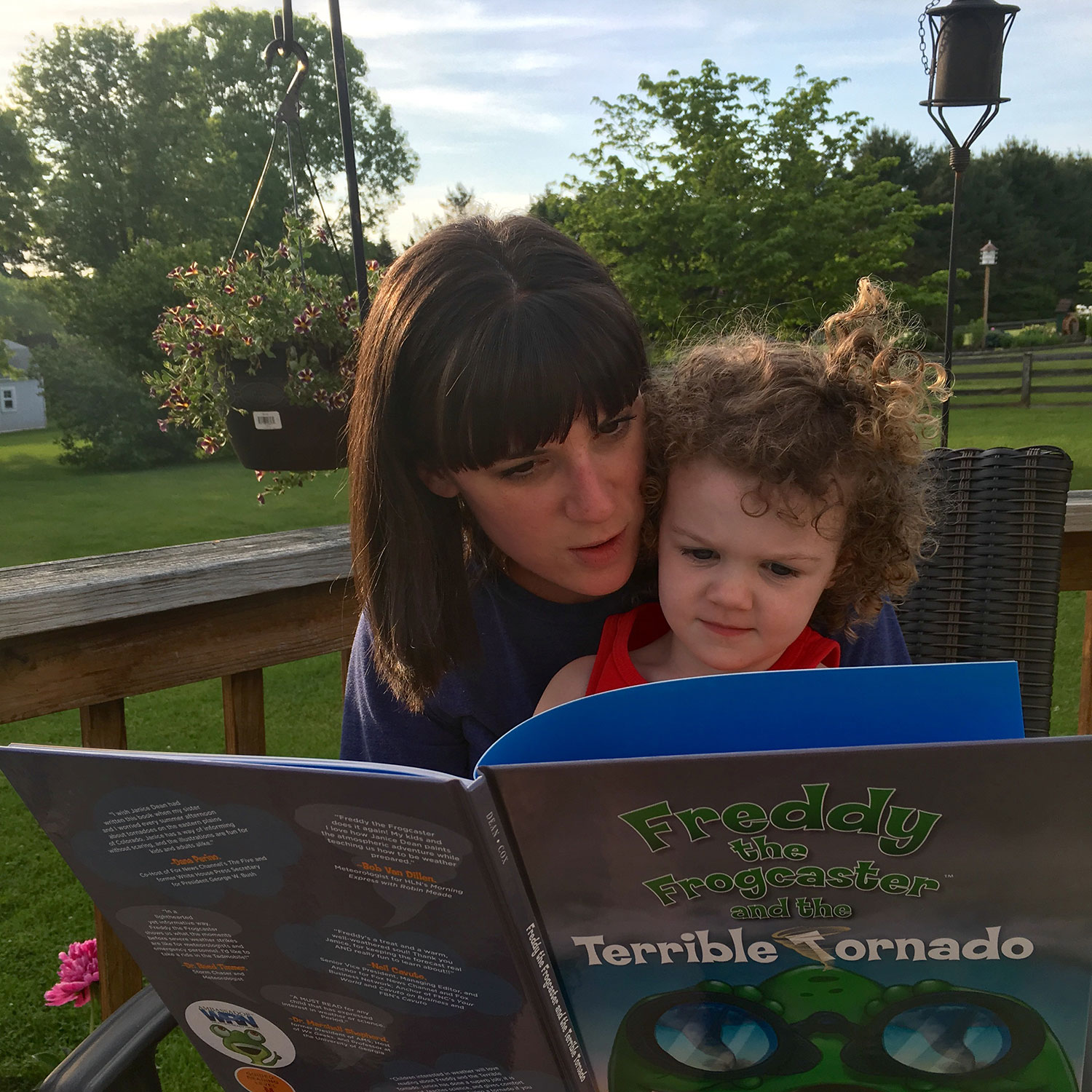 Katie Wheatley of ustornadoes.com reading to her daughter.
